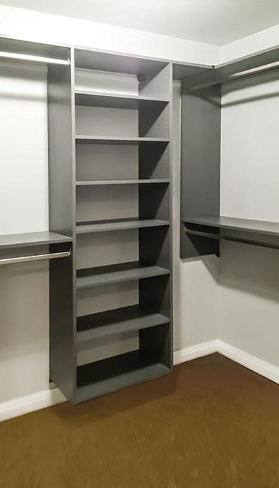Walk-in closet system with hanging space and shelves in Moonlight thermally fused laminate