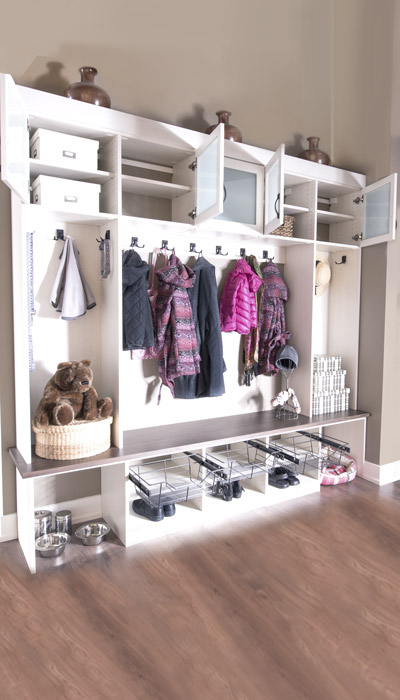 mudroom entryways with mudroom cubby and cabinet doors open