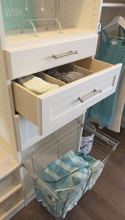 Built-in hamper and closet drawers to organize a bedroom closet