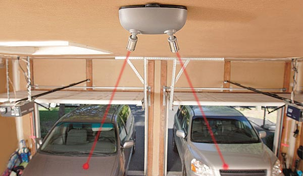 Garage accessory: laser park assist system for two car garage