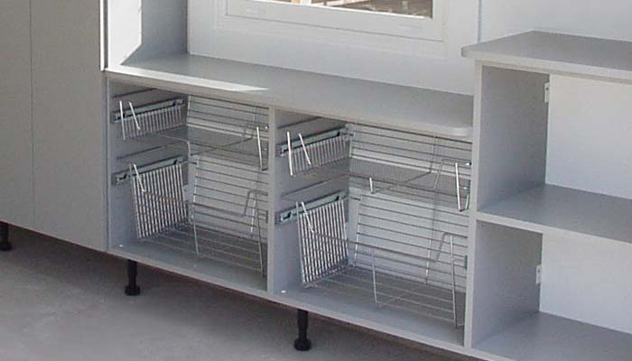 Custom garage cabinetry with shelving units and pull-out baskets