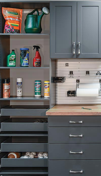 Garage tool bench and shelving system in Moonlight laminate with Omnitrack wall track