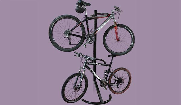 Garage accessory: Gravity stand holds two bicycles