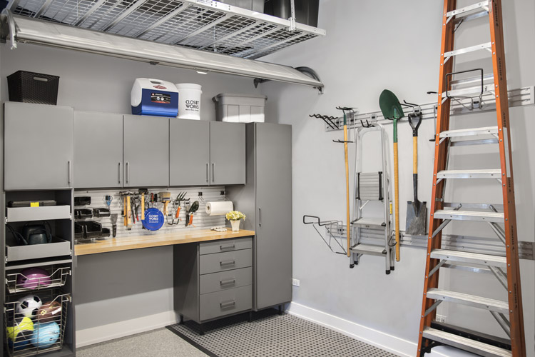 custom garage storage system with hooks for ladder and tools