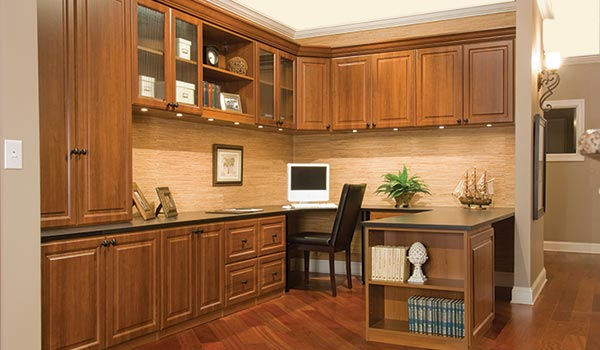 Traditional style custom home office storage with wrap around desk