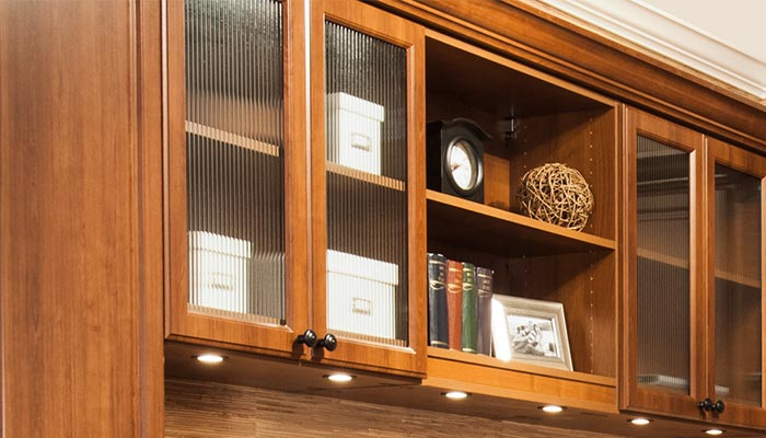 home office storage with custom cabinetry and reeded glass cabinet doors
