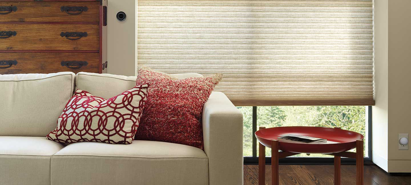 Duette honeycomb shades in the Alustra fabric collection by Hunter Douglas