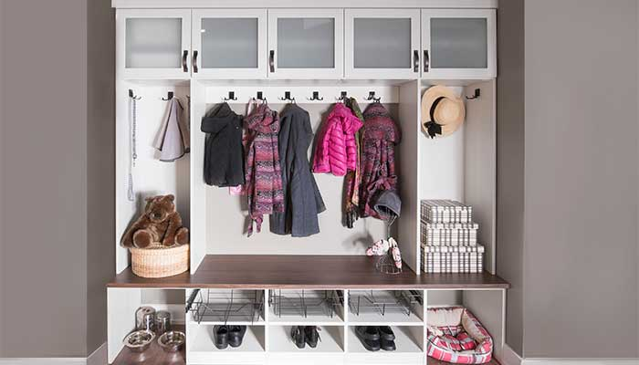 custom mudroom with storage for jackets and shoes