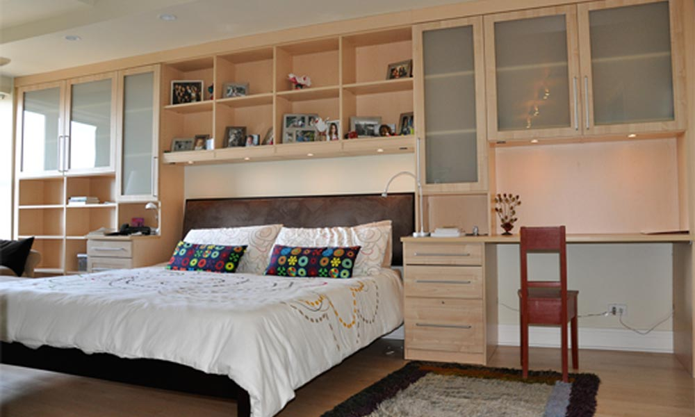 bedroom wall unit surrounds bed