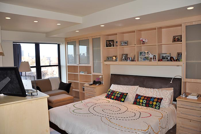 bedroom cabinetry surrounds bed and covers an entire wall with storage  solutions Wall Unit Bedroom Cabinetry