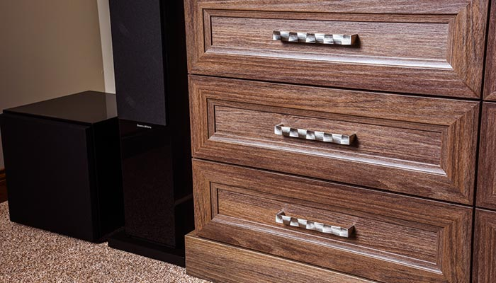 Detail of brushed chrome Aztec hardware on tradional media center
