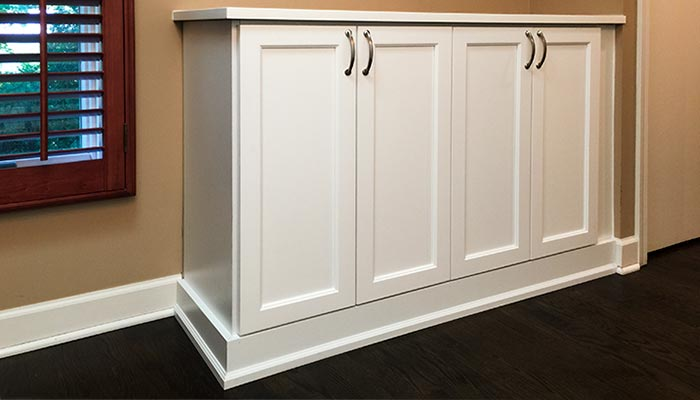 Custom credenza compliments wall unit organization system for hallway closet installed on opposite wall