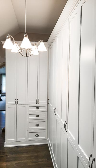 Wall unit designed to take advantage of under utilized hallway closet space