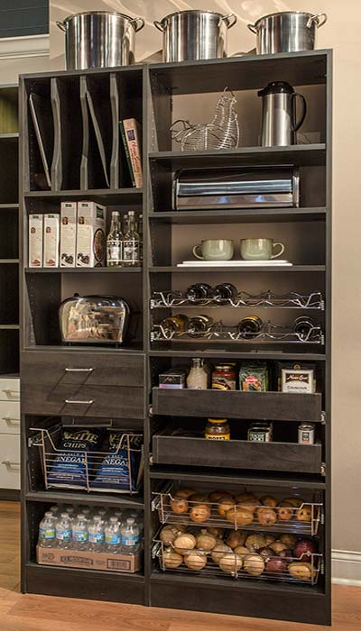 Simple pantry design with pull-out pantry shelves, accessories and stainless steel accents