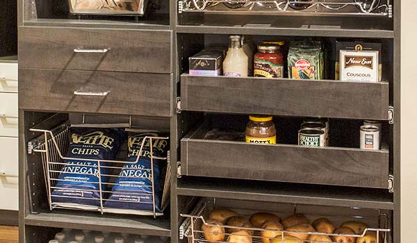 Custom pantry organizer provides pantry shelving for dry groceries, root vegetables and more