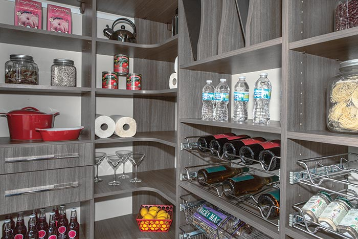 Custom corner pantry design with pull-out shelves and organizers for cans, bottles, wine, trays