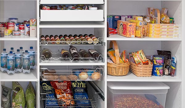 Custom reach-in pantry organizer with wire baskets, drawers and vertical tray organizer