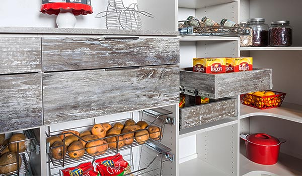 Custom pantry organizer with pull-out pantry shelving, accessories and country farmhouse feel