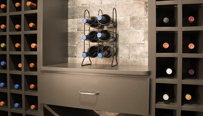 Arched wine closet nook for staging wine glasses and ice buckets