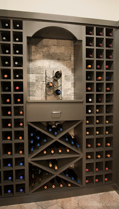 Wine wall with nook and drawer for cocktail napkins and bottle openers