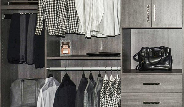 Custom reach-in closet with shelves and cabinets in gray wood