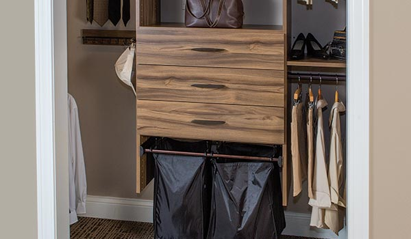 Brown reach-in closet with Synergy basket hamper