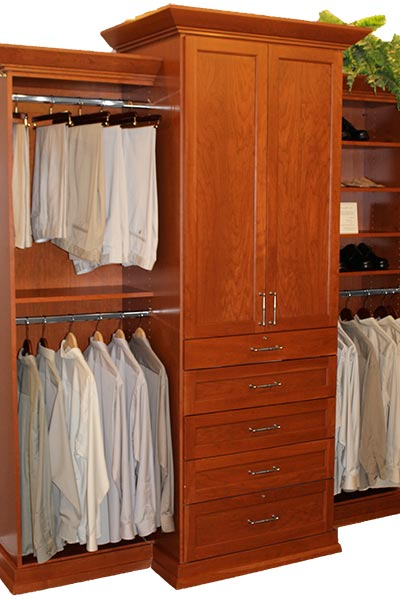 luxury reach-in closet system with marble topped hutch