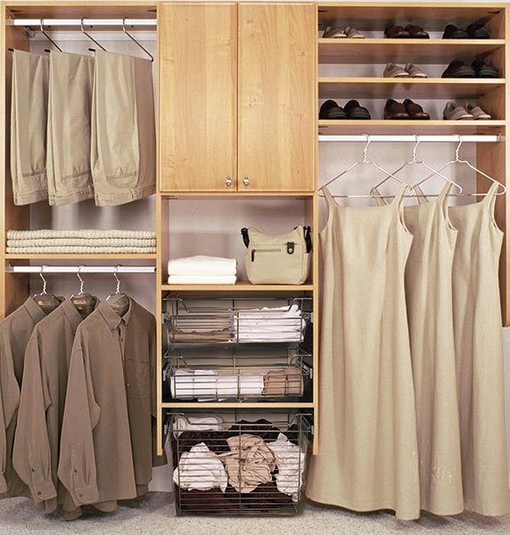 reach-in closet design with three wire baskets and upper cabinet