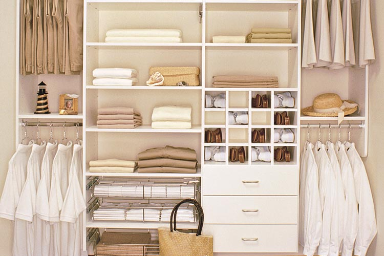 Reach-in wall mount closet organization system in white with shoe cubbies