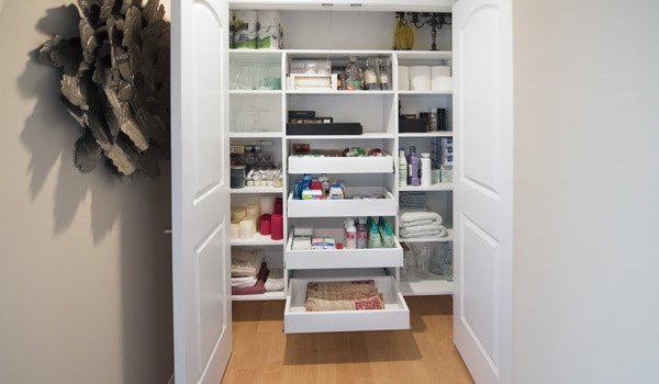 custom closet system used for linen, bathroom items, and home decor
