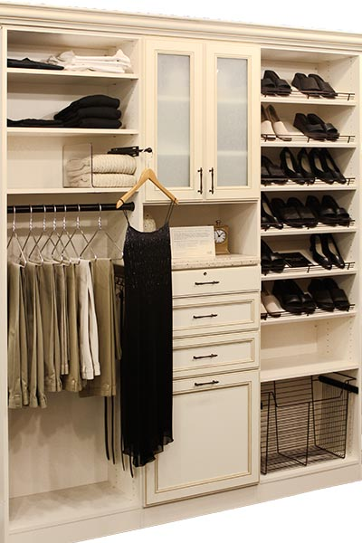 Custom closet system with frosted glass in ivory thermally fused laminate and oil rubbed bronze hardware