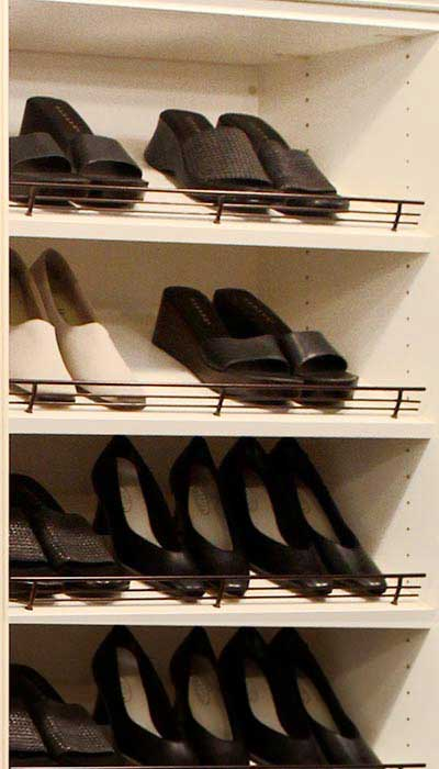 reach in wall style closet with shoe tower