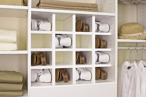 Shoe cubbies organize shoes in a small space