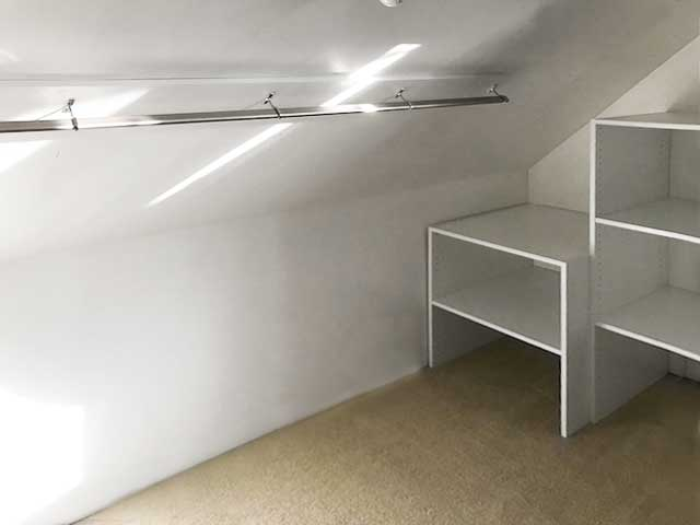 closet with slanted ceiling