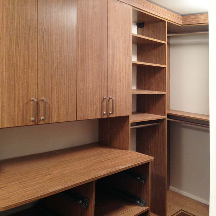Closet in amazona thermally fused laminate with brushed chrome hardware
