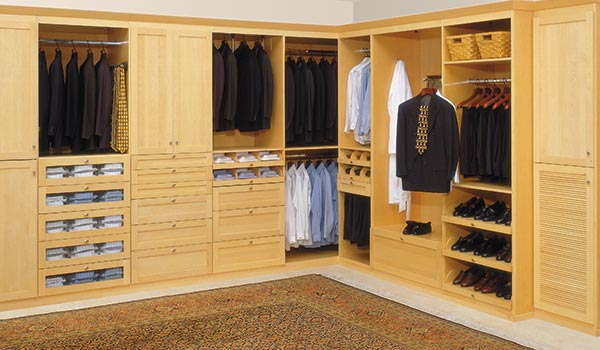 Custom contemporary walk-in closet designs in light wood