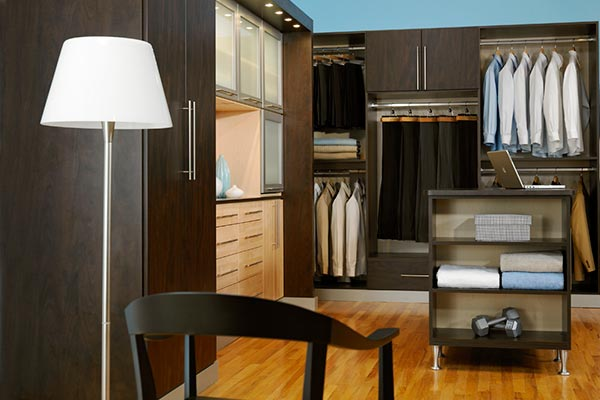 cocoa walk in closet with maple accents