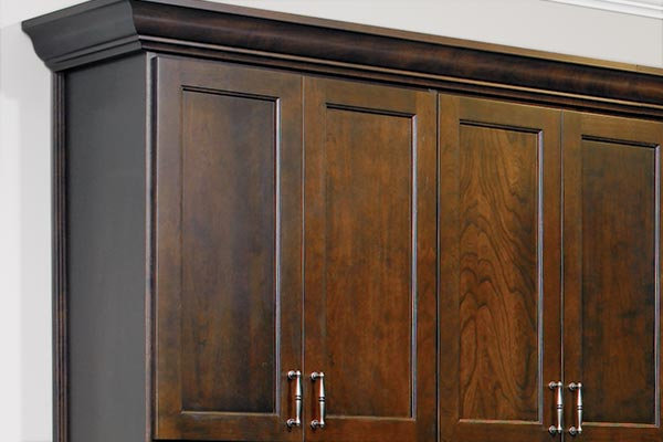 Crown moulding in rich, dark wood for closet system