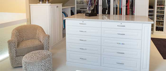 dressing room closet with comfortable seating area