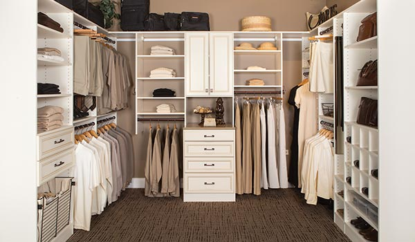 organized closet built to 84 inches height with top shelf for bulky storage