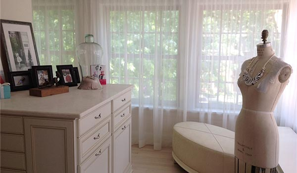 Dressing room and custom walk-in closet designs for a remodeled sleeping porch