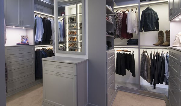 His and hers custom LED lit walk in closets systems