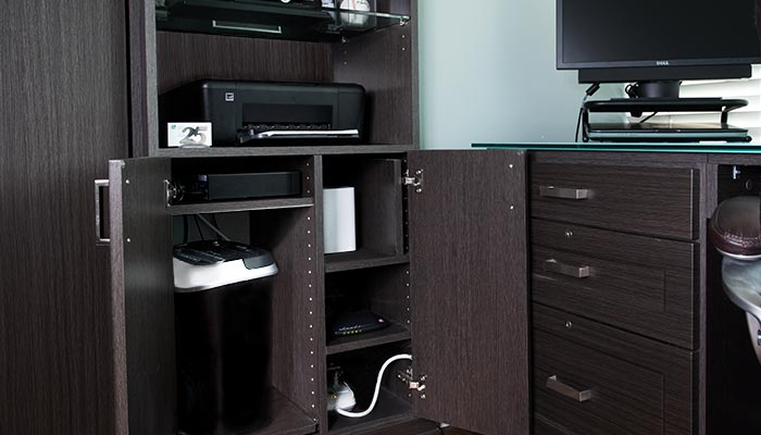 Home office solutions include a wall unit cabinet for electronics