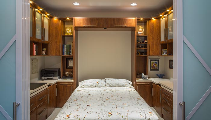 unique multipurpose room with wall bed for guests