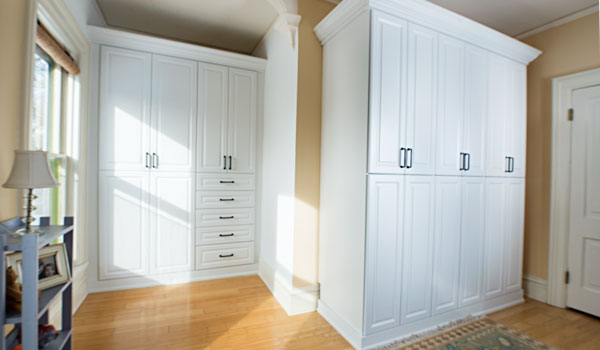 Custom wardrobe closet system for a historic home lacking wardrobe storage cabinets