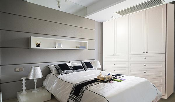 Custom wardrobe closet system for modern loft style bedroom in need of wardrobe storage cabinets