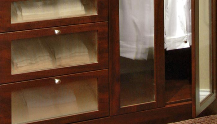 Glass closet doors and drawer front inserts used in stand alone closet
